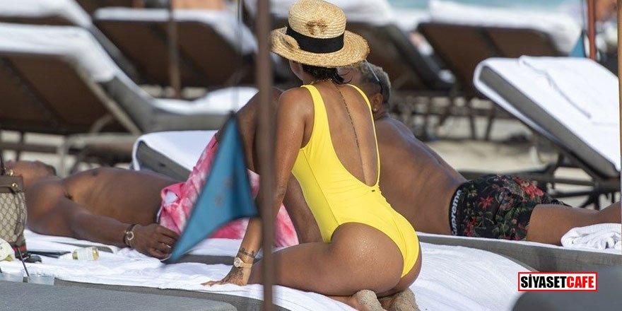 Karrueche Tran sarı mayosuyla plajı birbirine kattı