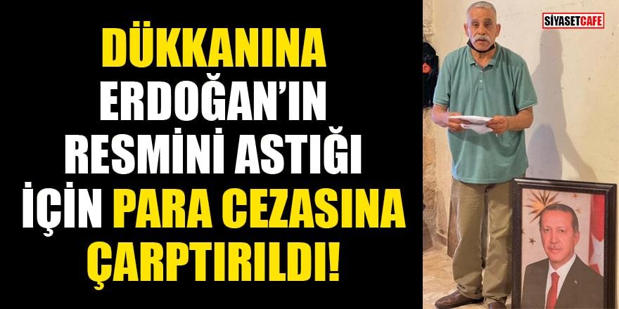 Dükkanına Cumhurbaşkanı Erdoğan'ın resmini astığı için para cezasına çarptırıldı