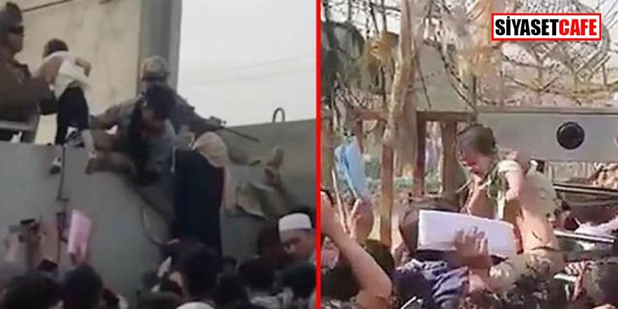 Taliban'dan kaçamayan anneler bebeklerini dikenli telin üzerinden böyle attılar!