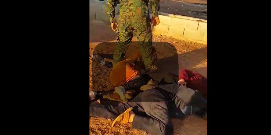 Terörist YPG'den sivillere işkence Üzerilerine pisledi