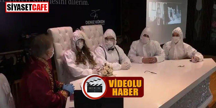 Sağlıkçı çift koruyucu tulumları ve maskeleriyle evlendi