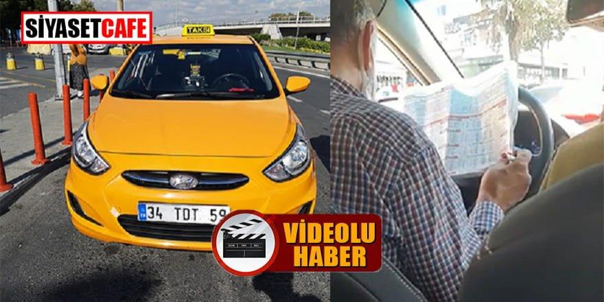 Araç sürerken at yarışı oynayan taksici yakalandı