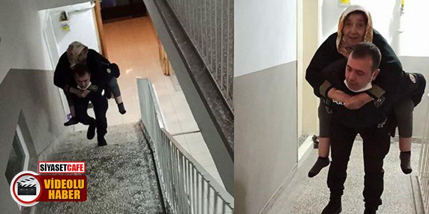 Çorum'da genç polis memuru 85 yaşındaki hastayı sırtında taşıdı!