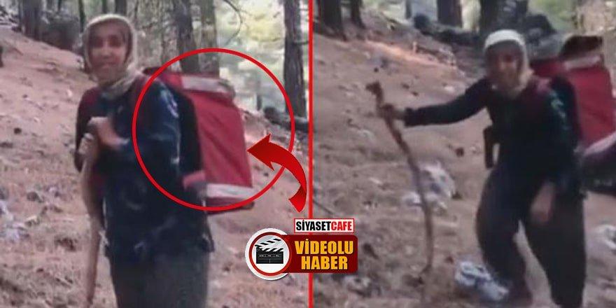 Yaşlı kadın, yangın ekiplerine sırtında erzak taşıdı